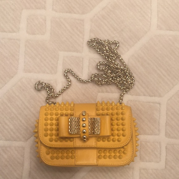 1a58fccfcac Christian Louboutin spiked sweet charity bag